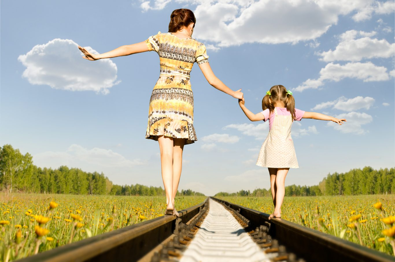 Balance with daughter on train tracks