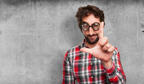 """Man holding up """"loser"""" finger sign."""