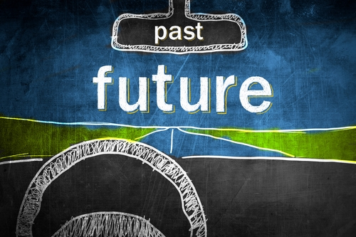 "Illustration of Car Driving Towards the Word ""Future"" with the word ""Past"" in the rearview mirror"