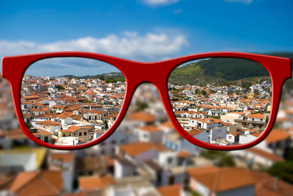 Blurry City Background Viewed Sharply through Red Glasses