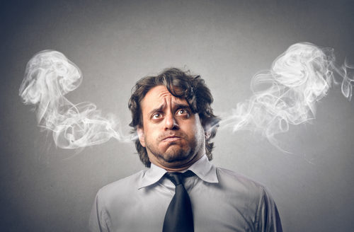 Stressed Out Businessman with Smoke Coming from Ears