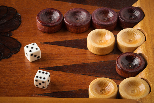 Close up of dice and backgammon board.